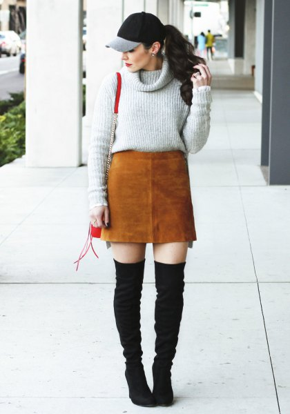 gray sweater with cowl neckline, brown suede skirt and black overknee boots