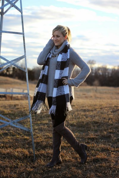 gray sweater with waterfall neckline and checked fringed scarf