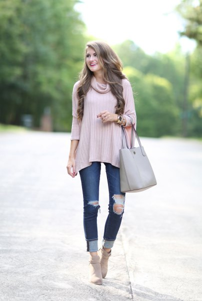 gray three-quarter sleeved sweater with a cowl neckline and ripped jeans with cuffs