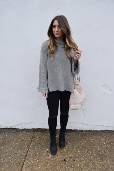 gray top with waterfall neckline and black super skinny jeans