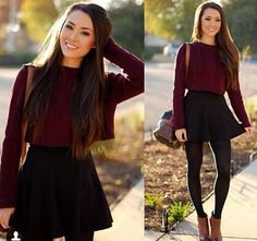 gray slim fit sweater with round neckline and black skater skirt with high waist