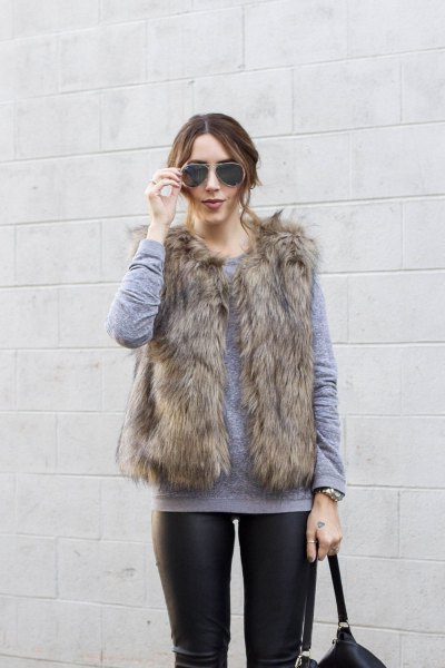 gray sweater with round neckline and brown faux fur vest