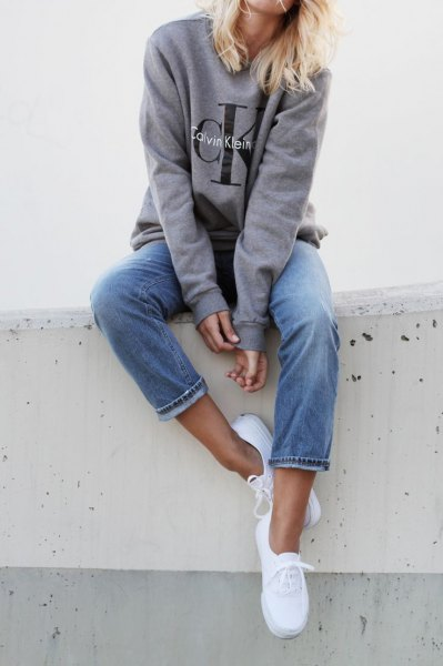 gray sweatshirt jeans sneakers with a round neckline