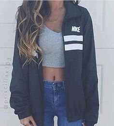 gray crop top with oversized windbreaker and blue skinny jeans