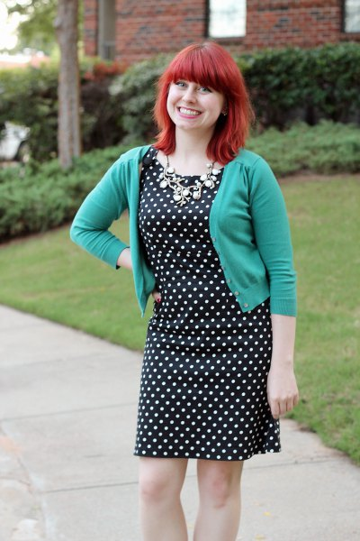 gray, short cut cardigan with a black and white polka dot dress