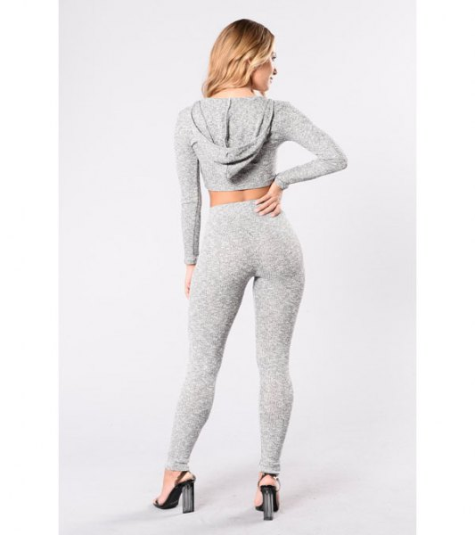 gray cropped hoodie with matching leggings and high-waisted heels