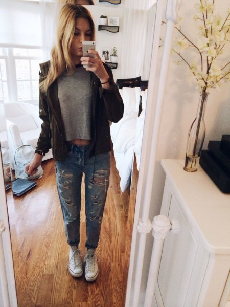 gray short t-shirt with black leather jacket and ripped jeans with cuffs