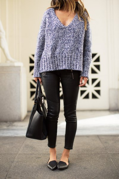gray, coarsely knitted sweater with deep V-neckline, leather pants and black, pointed flats