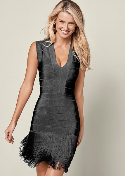gray, deep mini dress with deep V-neckline and fringes