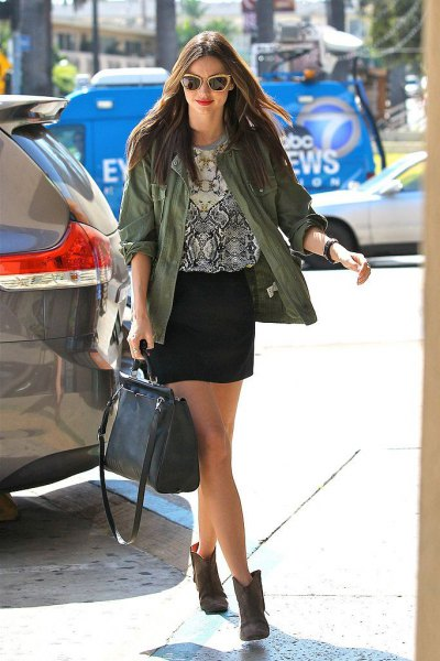 gray denim jacket with black and white printed t-shirt and mini skirt