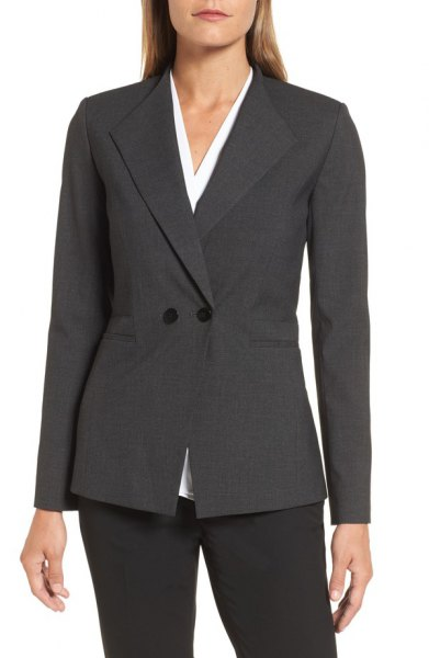 gray double-breasted slim fit suit with white blouse with V-neck