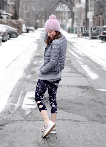 gray down jacket with black and white printed, narrow, short-cut leggings
