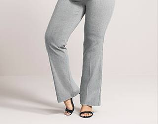 gray suit pants with black ankle straps and open toe heels