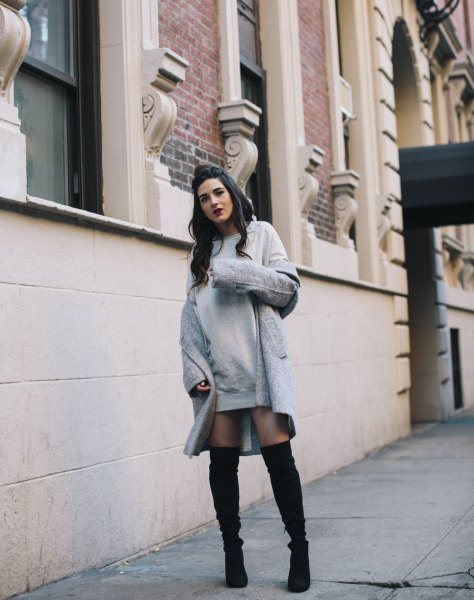 gray dress with a long wool coat and overknee boots