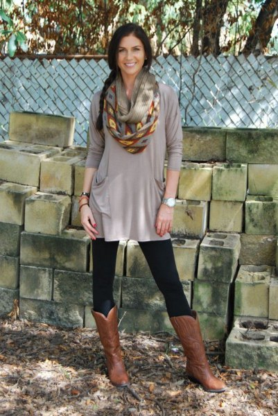 gray, elegant tunic top with leggings and knee-high boots made of brown leather