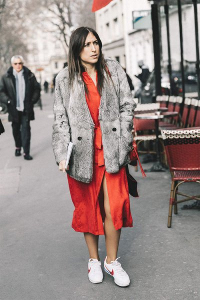gray faux fur coat with an orange midi dress and white hiking tennis shoes
