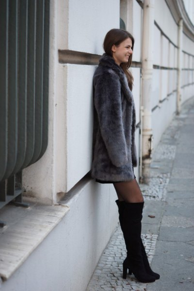 gray faux fur coat with black thigh high boots