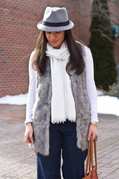 gray faux fur vest with white long-sleeved T-shirt and matching scarf
