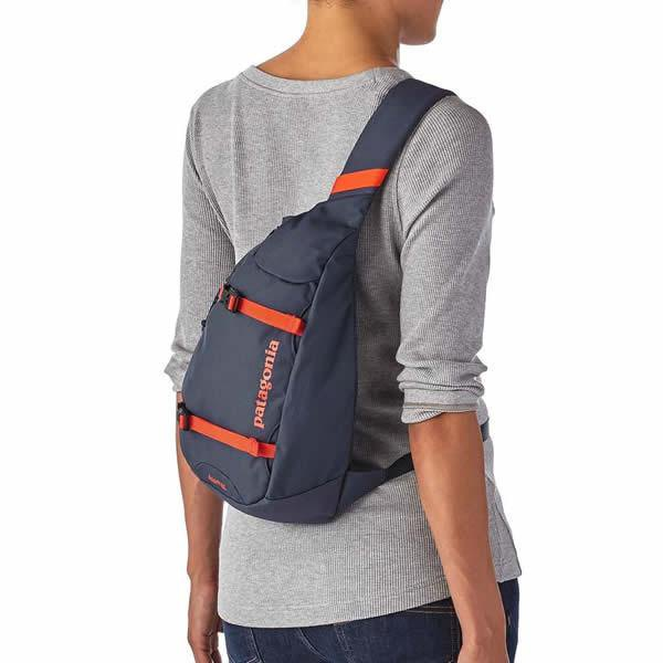 gray long-sleeved t-shirt with purple shoulder bag