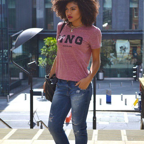 gray t-shirt with fitted print and blue slim fit jeans