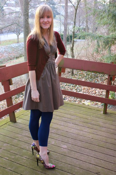 gray, flared, knee-length dress with dark blue, footless tights