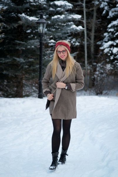 gray wrap dress made of fleece with stockings and black snowshoes
