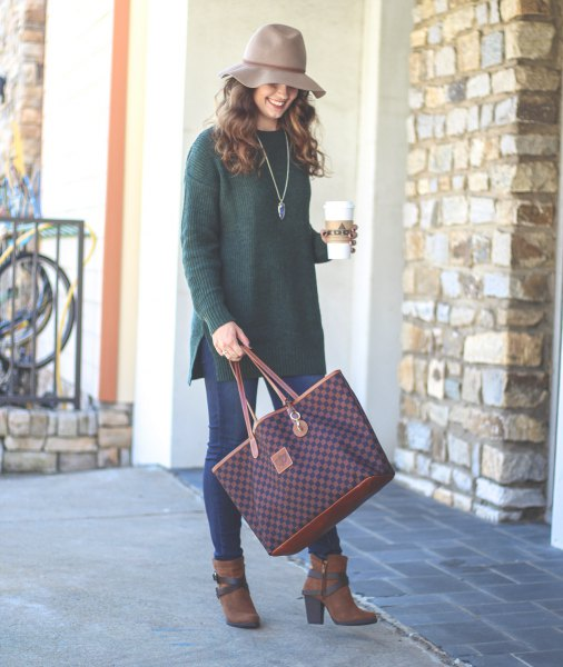gray floppy hat with ribbed tunic sweater and blue skinny jeans
