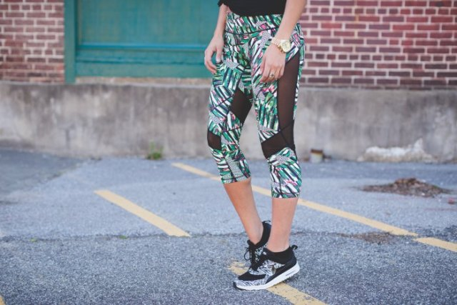gray, cropped mesh leggings with floral pattern and matching running shoes