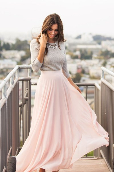 gray, figure-hugging knitted sweater with white, floor-length, flowing skirt