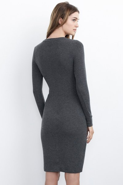 gray, figure-hugging long-sleeved jersey knit dress with light pink heels