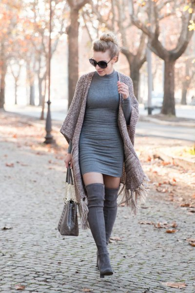 gray, figure-hugging sweater dress with matching fringed cape