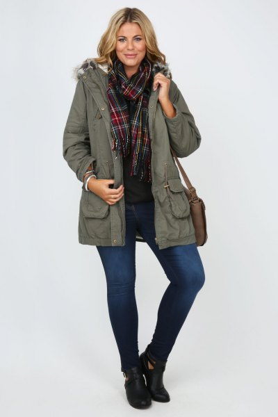 Parka coat with gray fur, black shirt and checked scarf