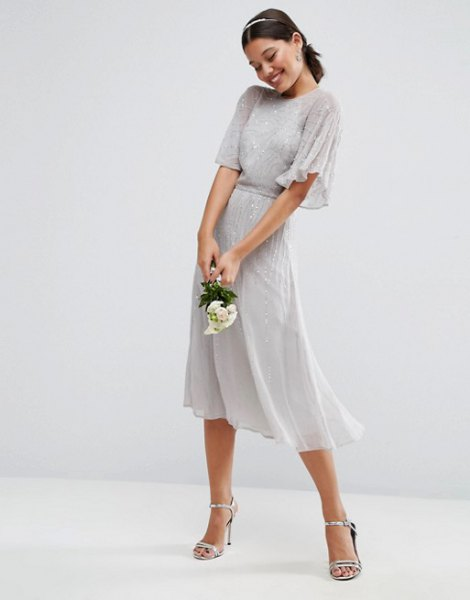 gray midi dress with a gathered waist and fluttering sleeves