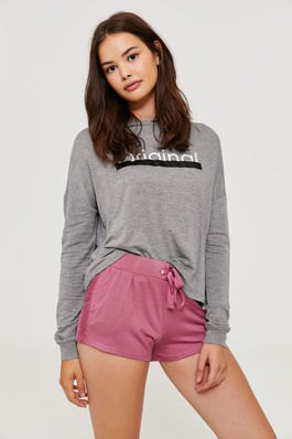 gray graphic sweatshirt with blushing pink high-waisted sweat shorts