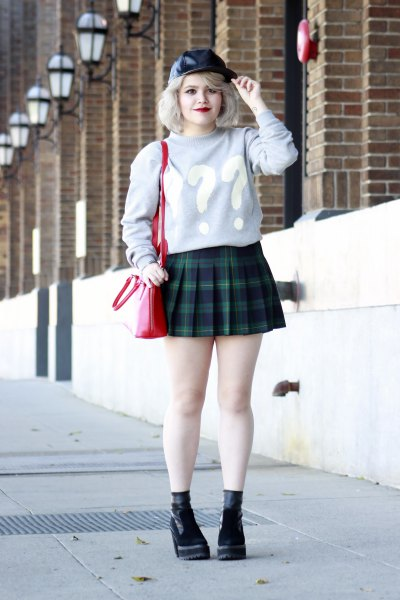 gray graphic sweater with dark blue checked mini pleated skirt
