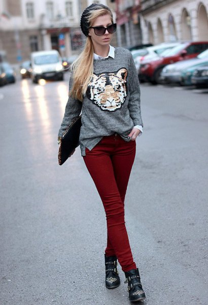 gray graphic sweater with white shirt with buttons and maroon skinny jeans