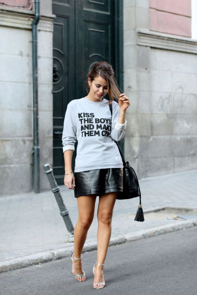 gray graphic sweatshirt with black mini leather skirt