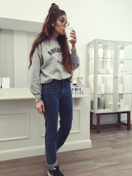 gray graphic sweatshirt with blue mom jeans with cuffs