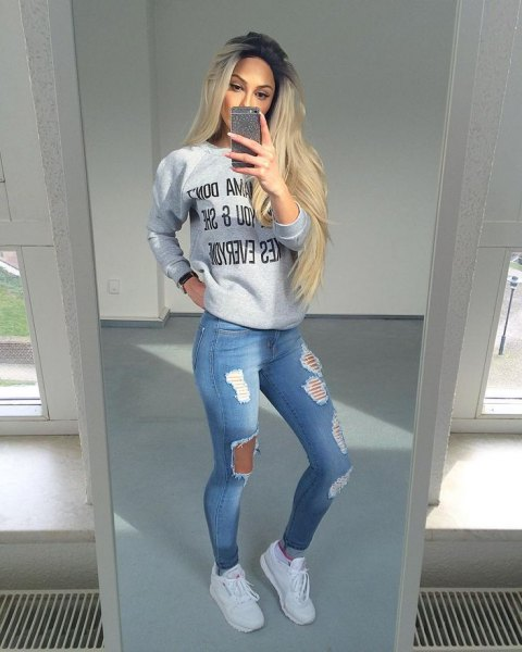 gray graphic sweatshirt with light blue jeans