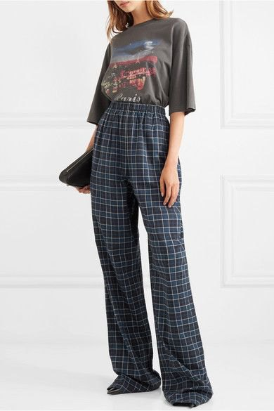 gray graphic t-shirt with blue high-rise pants made of checked flannel with wide legs