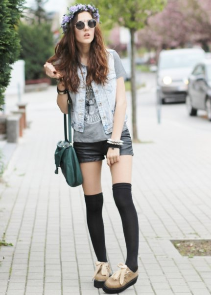 gray graphic t-shirt with light blue denim vest and gray suede derby shoes