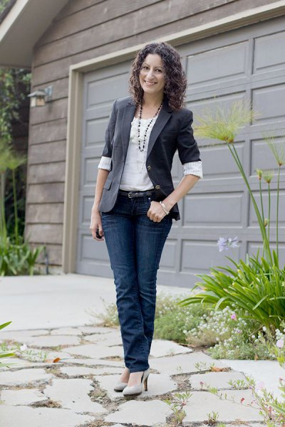 gray half-sleeve blazer with white blouse and dark jeans
