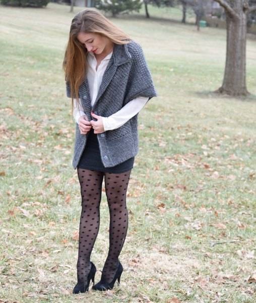 gray cardigan with half sleeves, black, figure-hugging mini skirt and dotted tights