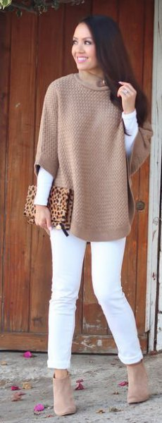 gray half-sleeved sweater with white long-sleeved T-shirt and slim-fit jeans
