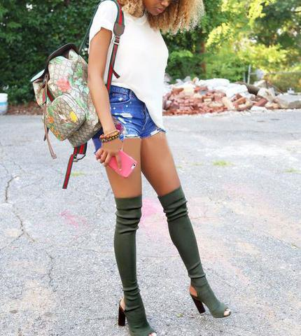 gray heeled boots, white T-shirt and blue denim shorts