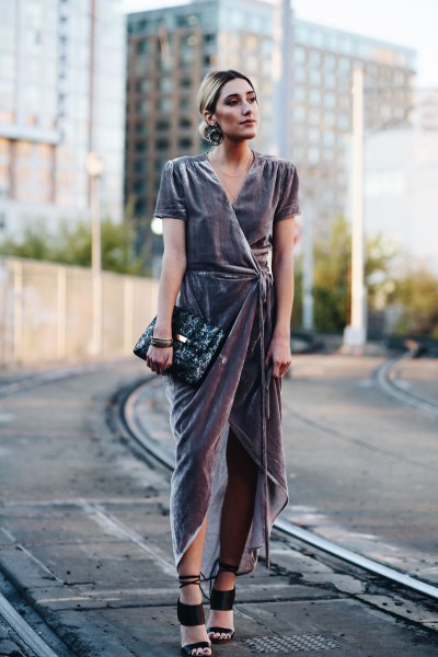 gray high low maxi dress with black clutch