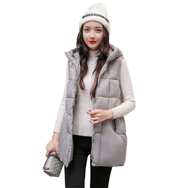 gray down vest with hood and white, ribbed sweater with stand-up collar