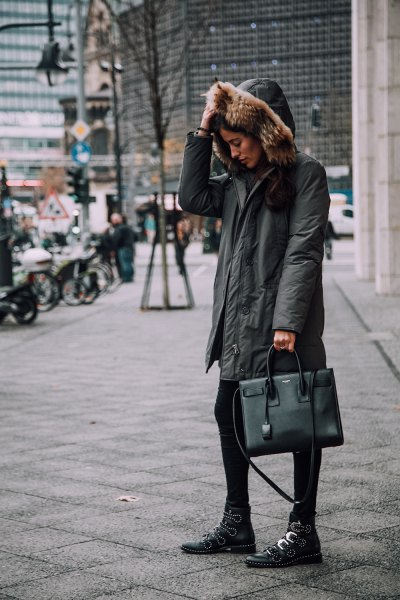 gray oversized bomber jacket with hood, black leggings and boots