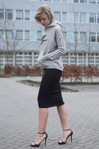 gray hoodie with black mini skirt and open toe heels