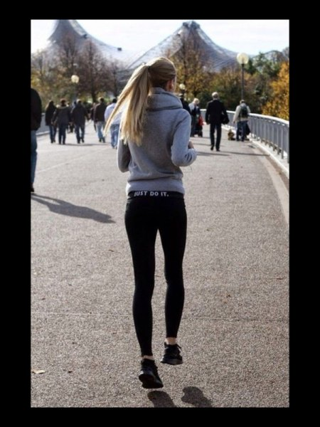gray hoodie with black running shorts and sneakers